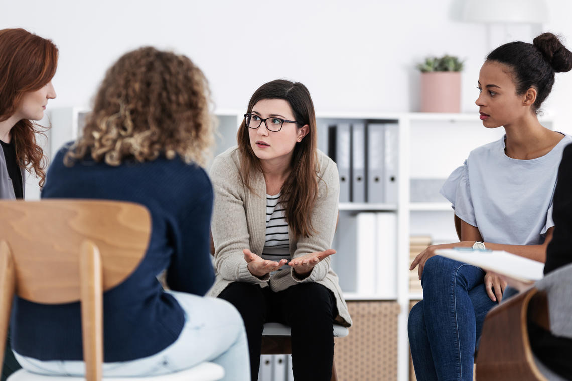 Psychologists talking in a classroom