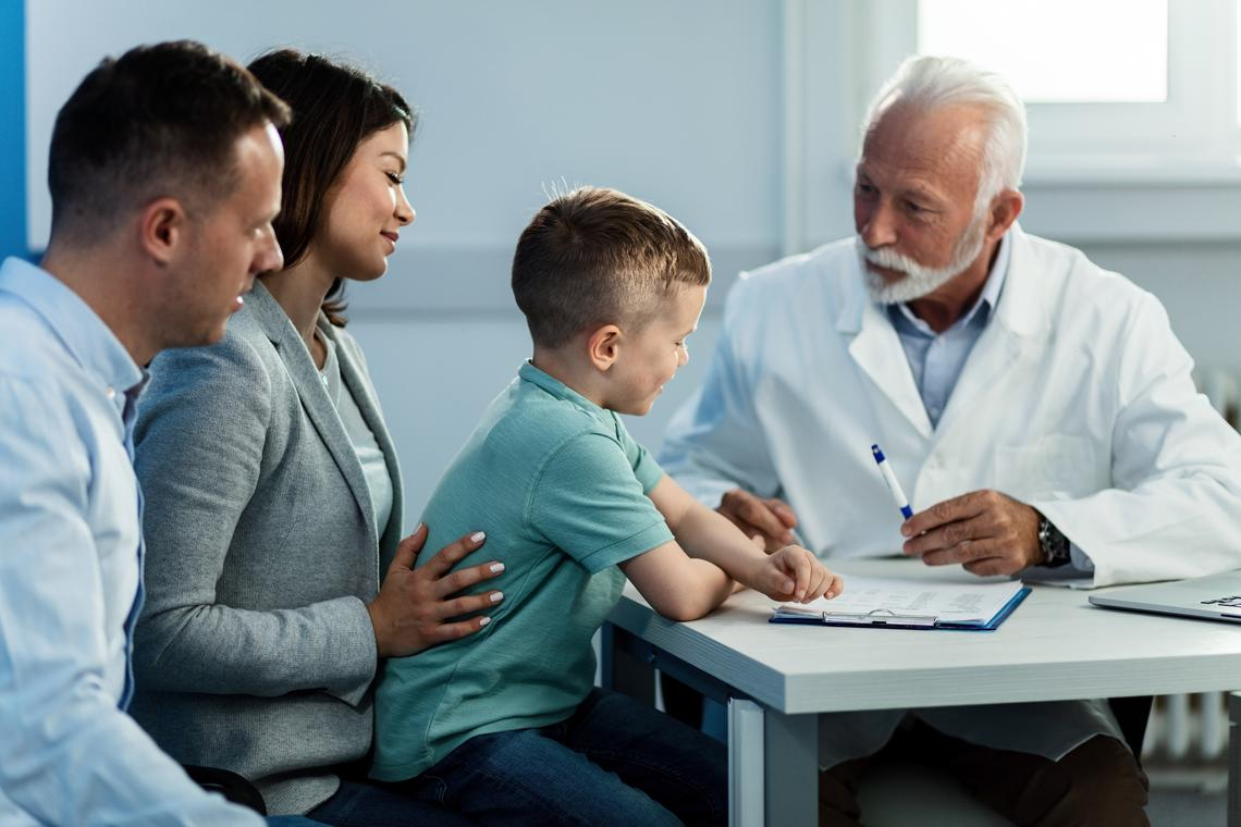 Doctor speaking to a family